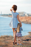 Mother and his adorable little daughter at beach stock images