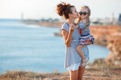 Mother and his adorable little daughter at beach royalty free stock image