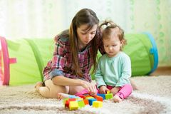 Mother with his child daughter play together Stock Photos