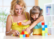 Mother with his child girl play together Stock Image