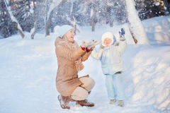 Mother with his Child playing in Winter Stock Image