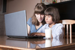 Mother and his son looking at lap top Stock Photography