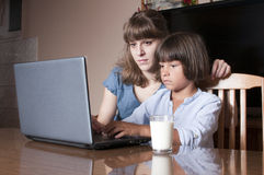 Mother and his son looking at lap top Stock Images