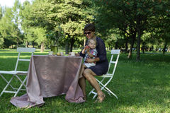 Mother and his son at table Royalty Free Stock Photography