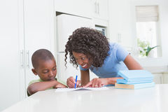 Mother with his son working Royalty Free Stock Images