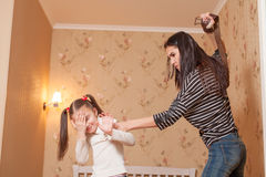 Mother hit her ldaughter with belt. Stock Image