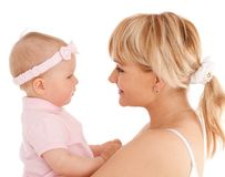 Mother hold baby girl and look at her eyes Stock Photos