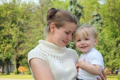 Mother hold baby on hands outdoor Royalty Free Stock Photography
