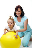 Mother hold daughter on Fitness Ball. Over white Stock Image
