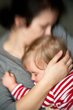 Mother hold sleeping baby Stock Photos