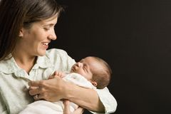 Mother holding baby. stock image