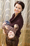 Mother holding baby in arms Stock Images