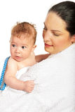 Mother holding baby boy after bath Royalty Free Stock Photo