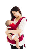 Mother holding a baby Stock Photography
