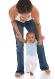 Mother Holding Baby for the First Step Stock Photo