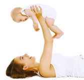 Mother holding baby, fun, exercise Stock Photo