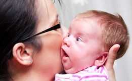 Mother holding baby girl Stock Photos
