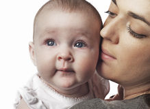 Mother holding baby girl stock photo