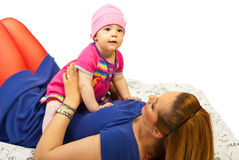 Mother holding baby girl on her belly Royalty Free Stock Images