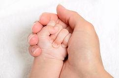 Mother holding a baby hand Royalty Free Stock Photo