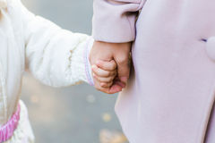 Mother holding baby hand Royalty Free Stock Photo