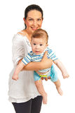 Mother holding baby with long drool Stock Images