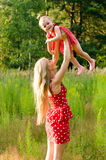 Mother holding a baby in nature Royalty Free Stock Photography