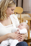 Mother Holding Baby In Nursery Royalty Free Stock Photos