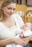 Mother Holding Baby In Nursery Stock Photos