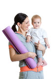 Mother holding baby ready to fitness Royalty Free Stock Photos