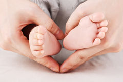 Mother holding baby's feet Stock Photography