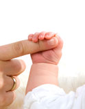 Mother is holding baby's hand Stock Image