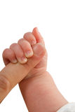 Mother is holding baby's hand Stock Photo