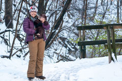 Mother Holding Baby During Walk in Snow Royalty Free Stock Photography