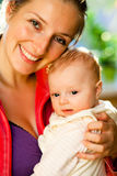 Mother holding beautiful baby girl Royalty Free Stock Images