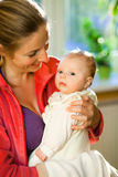Mother holding beautiful baby girl Royalty Free Stock Photography