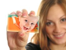 Mother holding card with baby collage Stock Photo