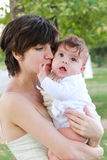 Mother holding a child Stock Image