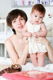 Mother holding a child Royalty Free Stock Image