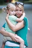 Mother holding child girl and looking with love Stock Photos