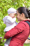 Mother holding child on her hands Stock Images