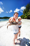 Mother holding crab Stock Images