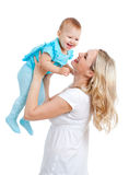 Mother holding cute baby over white. Background Royalty Free Stock Image
