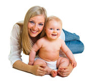 Mother holding cute infant girl Stock Photo