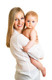 Mother holding cute infant girl Stock Images