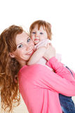 Mother holding daughter Royalty Free Stock Image