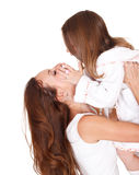 Mother holding daughter Stock Images