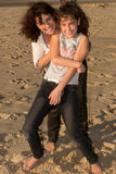 Mother is holding daughter at beach Royalty Free Stock Photo