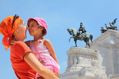 Mother is holding daughter, equestrian monument Stock Photos