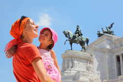 Mother is holding daughter, equestrian monument Royalty Free Stock Photo